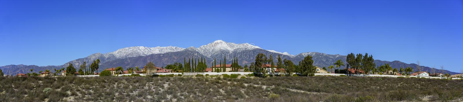 Beautiful Mount Baldy view from Rancho Cucamonga. Beautiful snowy Mount Baldy with some building below, view from Rancho Cucamonga royalty free stock photos