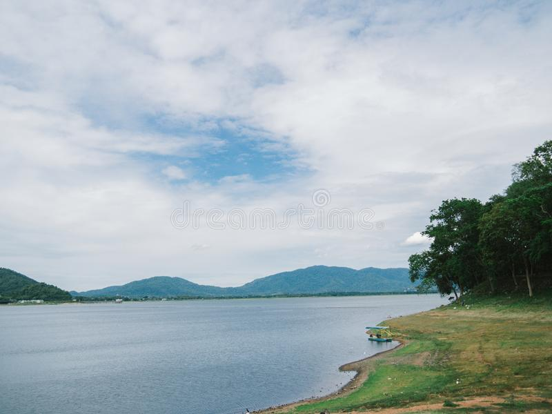 Beautiful mountain, blue sky and water viewpoint of Bang Pra Reservoir, Thailand. It`s one of famous tourist attraction and great. Relax place, Beautiful stock photo