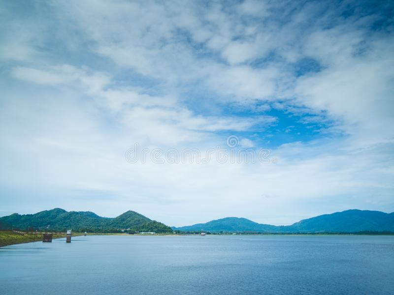 Beautiful mountain, blue sky and water viewpoint of Bang Pra Reservoir, Thailand. It`s one of famous tourist attraction and great. Relax place, Beautiful royalty free stock photo