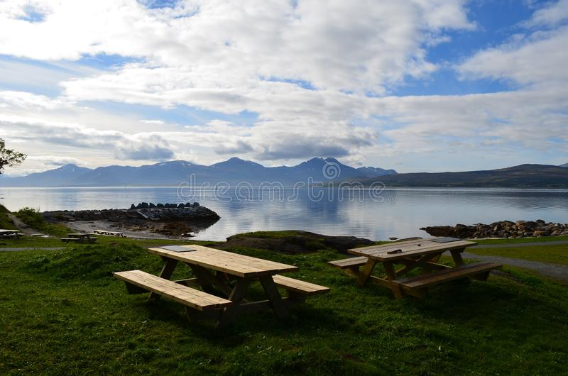 Beautiful mountain and fjord landscape with wooden park benches stock photo