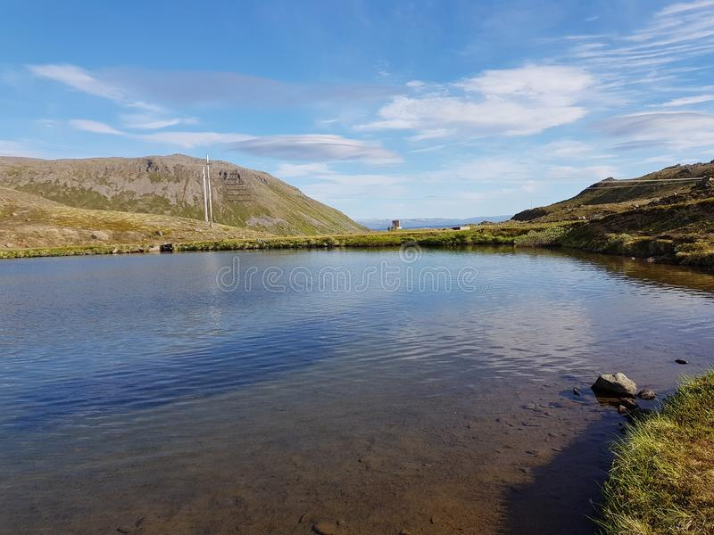 Beautiful mountain and fresh water lake view on mageroya, north cape county stock photography