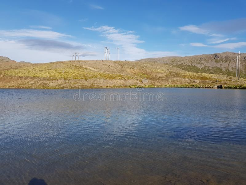 Beautiful mountain and fresh water lake view on mageroya, north cape county.  royalty free stock photography
