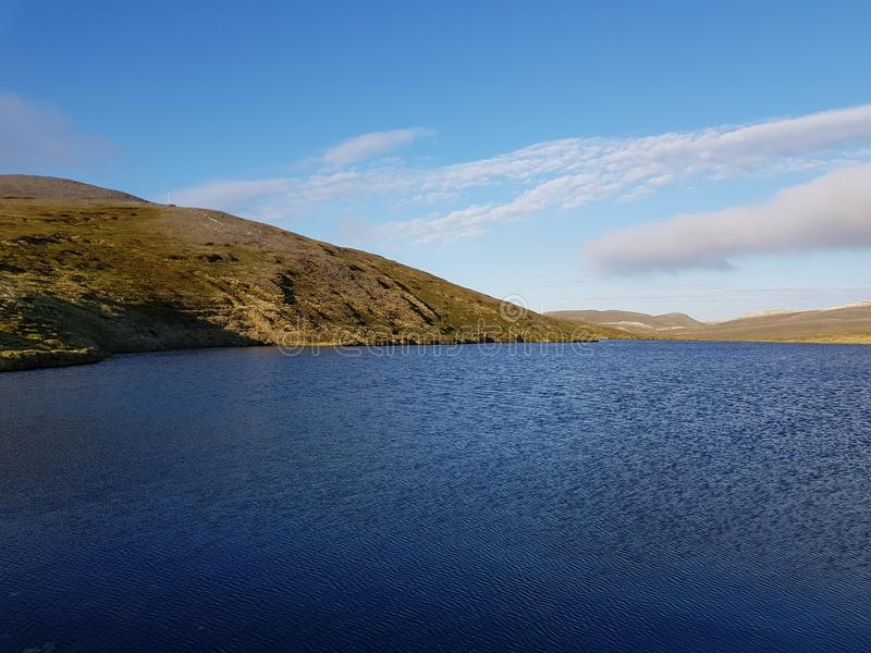 Beautiful mountain and fresh water lake view on mageroya, north cape county.  royalty free stock images
