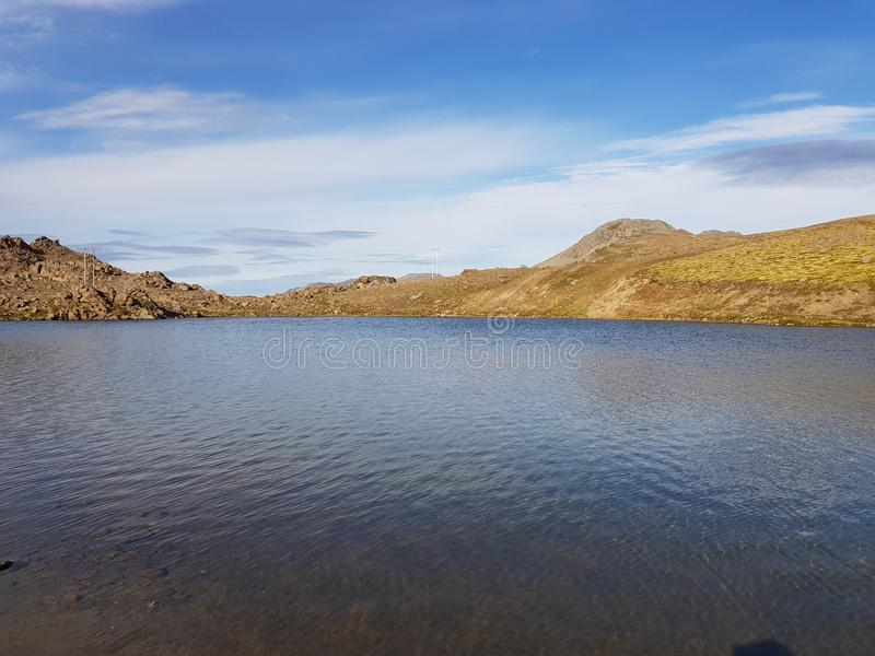 Beautiful mountain and fresh water lake view on mageroya, north cape county.  stock images