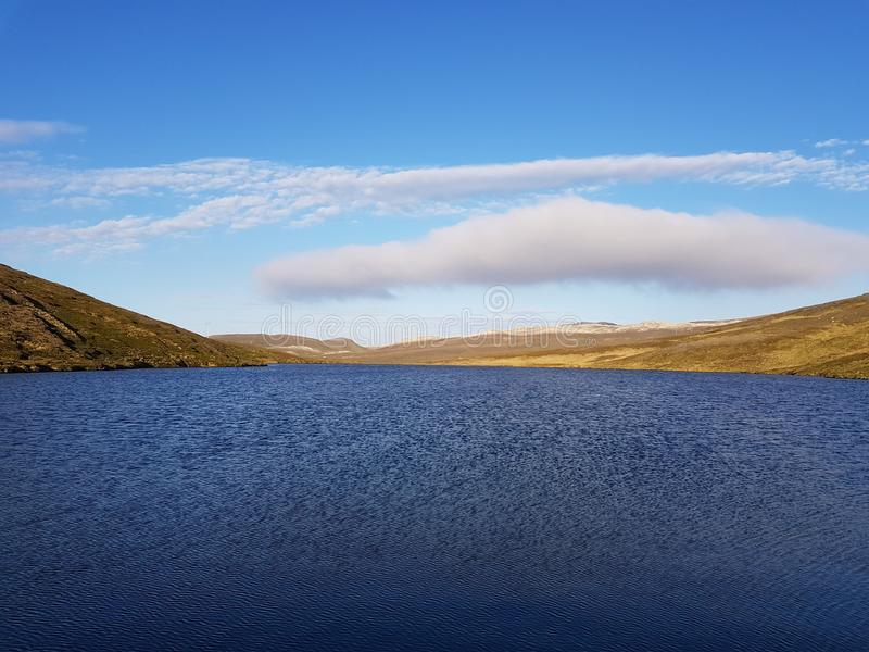 Beautiful mountain and fresh water lake view on mageroya, north cape county.  stock photos