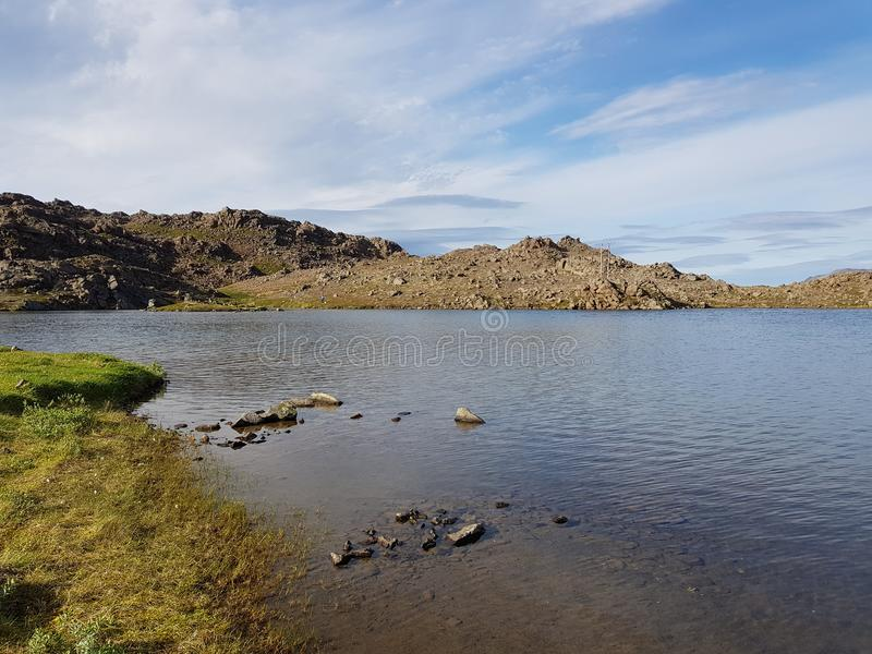 Beautiful mountain and fresh water lake view on mageroya, north cape county royalty free stock photography