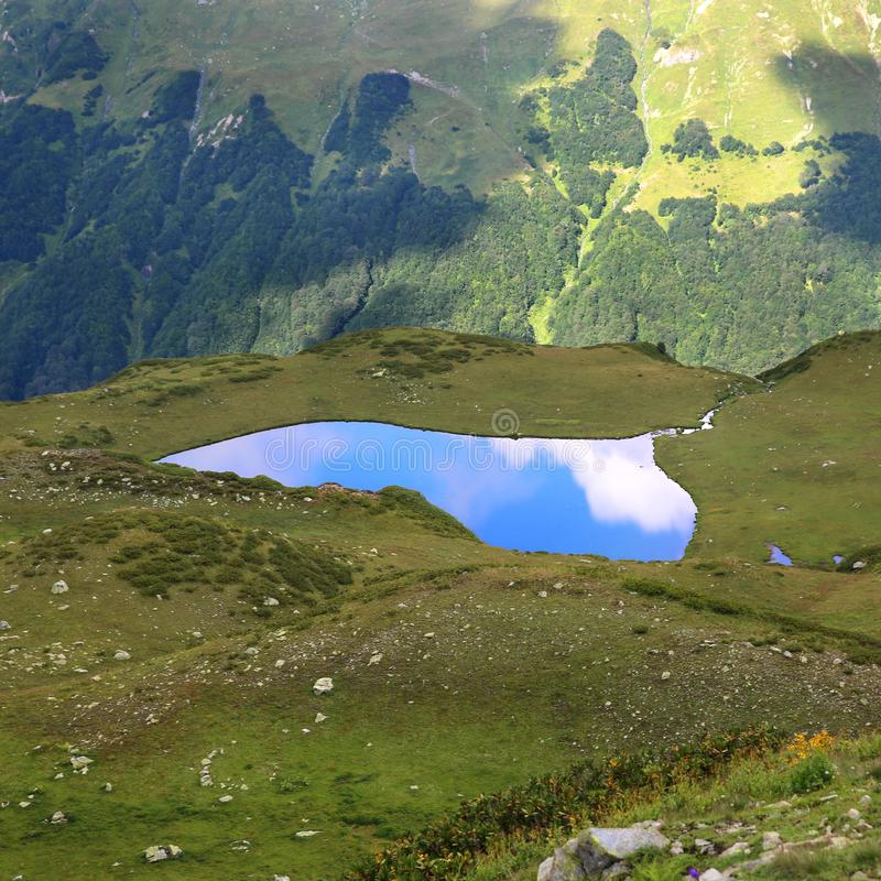 Beautiful mountain lake in the form of a heart stock photography