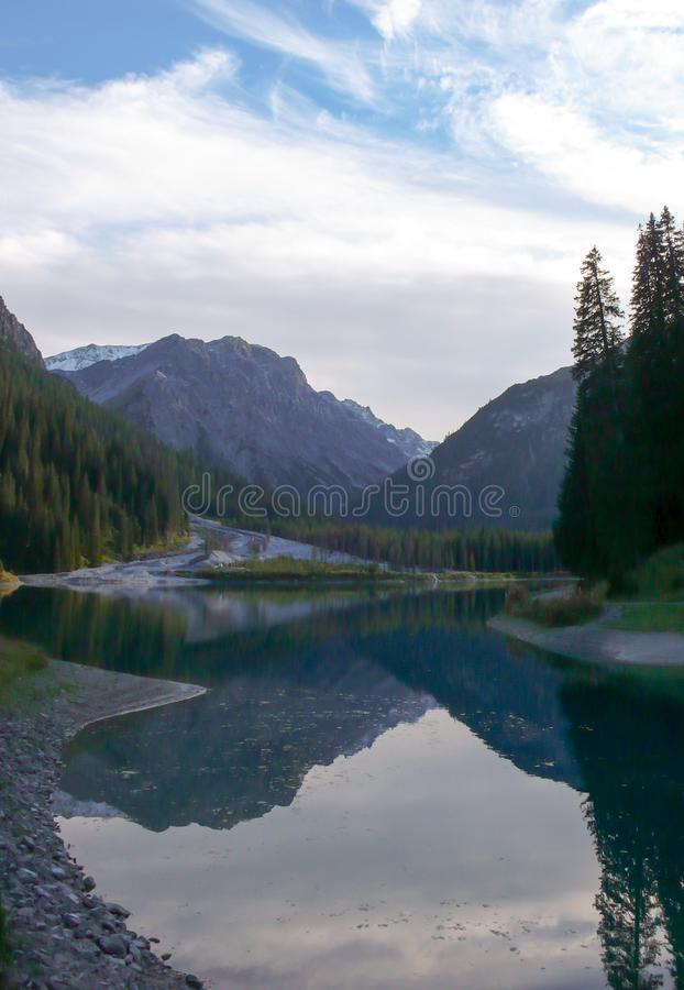 Beautiful mountain lake and landscape in the Swiss Alps near Arosa in late autumn with fall colors stock photo