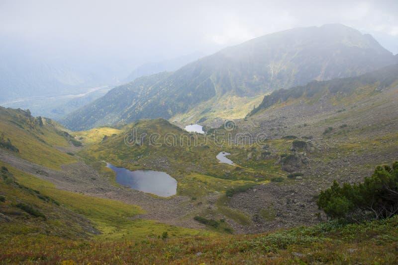 Beautiful mountain lake surrounded by impressive mountains of th. E Khamar-Daban. Beautiful scenery stock images