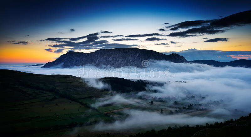 Beautiful mountain landscape in foggy morning in Alba, Romania. Beautiful mountain landscape in foggy morning in Alba county, Romania royalty free stock photography