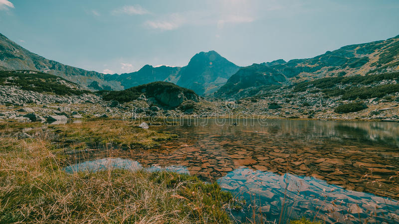 Beautiful mountain landscape. A lake surrounded by mountains in Retezat National Park stock image