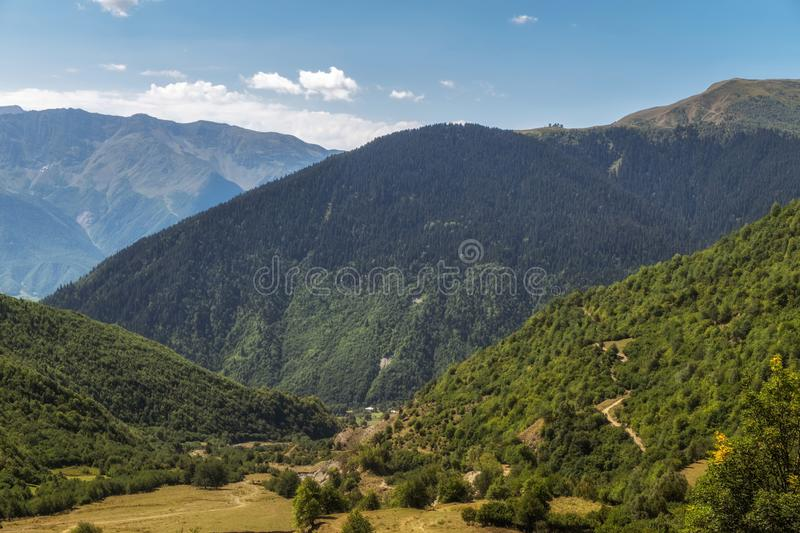 View to a valley from high in mountains stock image