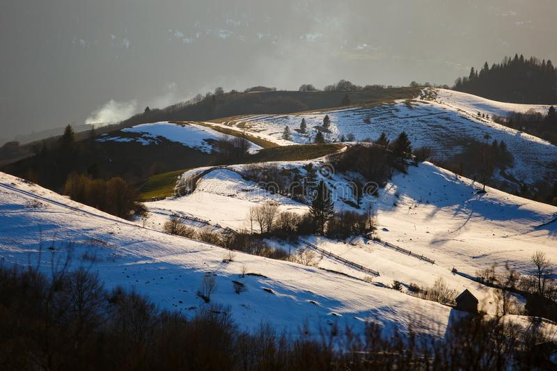 Beautiful mountain landscape in rural area. Melting snow on slopes stock photos