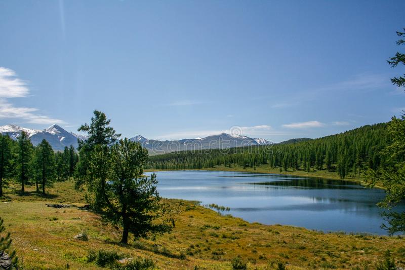 Beautiful mountain landscape. Snow-capped mountains, lake stock image