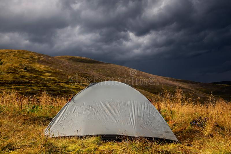 Beautiful mountain landscape in stormy weather with a tourist tent. Carpathian mountains of Ukraine. Holidays in the mountains stock photography