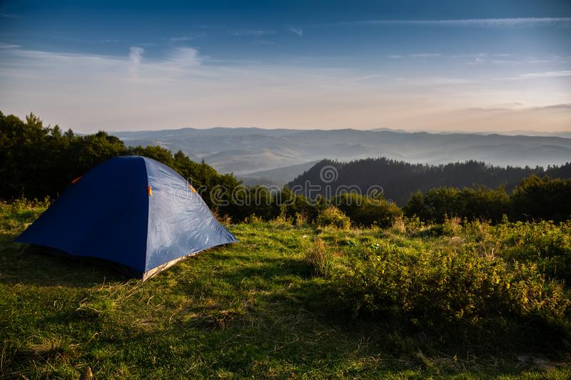 Beautiful mountain landscape with a tourist tent. Carpathian mountains of Ukraine. Holidays in the mountains stock images