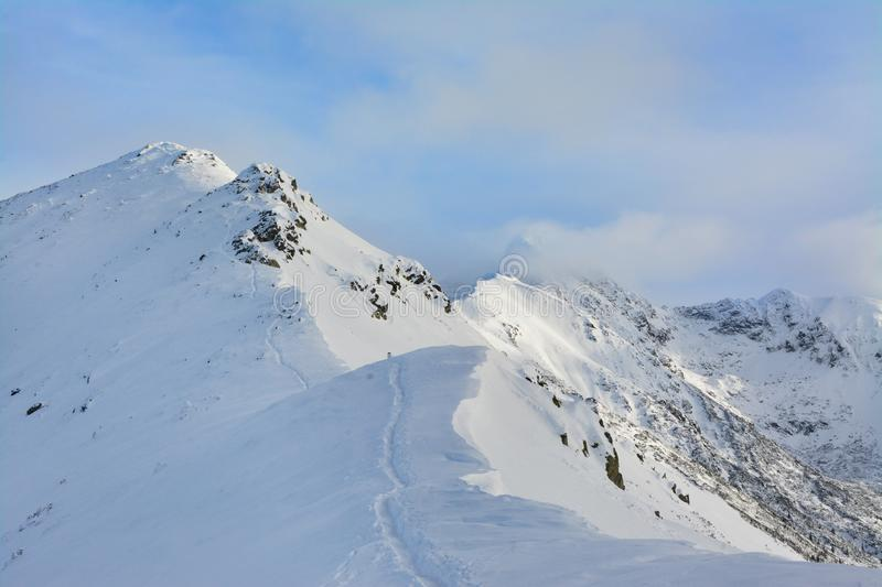 Beautiful mountain peaks in the winter. Tatra Mountains. Beautiful panorama of winter Tatra Mountains. Poland royalty free stock images