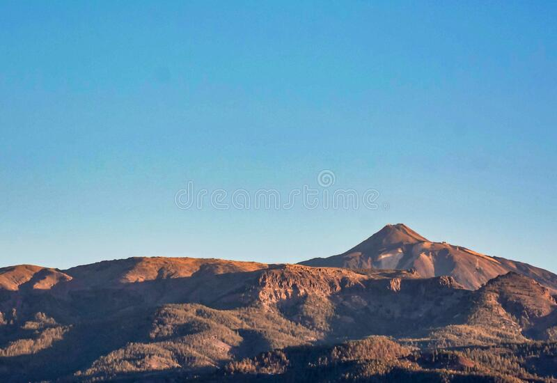 Beautiful mountain range of mountains under a clear sky in the Canary Islands, Spain. A beautiful mountain range of mountains under a clear sky in the Canary stock photography