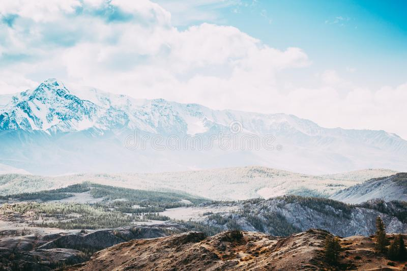 Beautiful mountain range under the clouds. Snowy peaks of rocks stock images