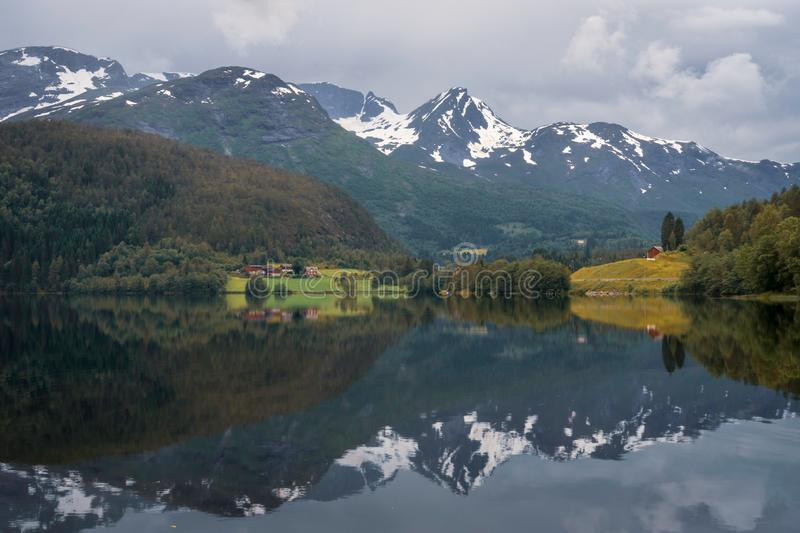 Beautiful mountain scenery and reflections in Lake in the western part of Norway. royalty free stock images
