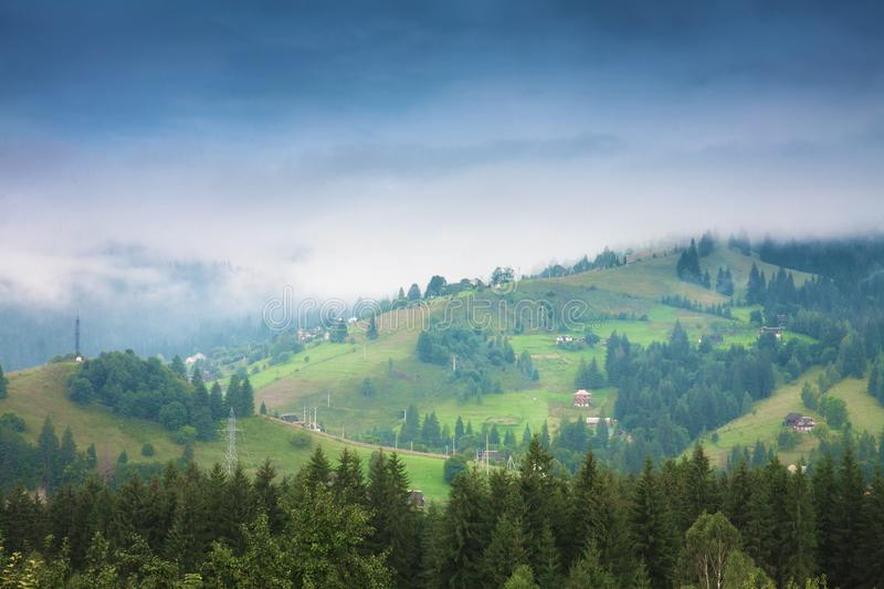 Beautiful mountain summer landscape. Mountain peaks misty morning stock photos