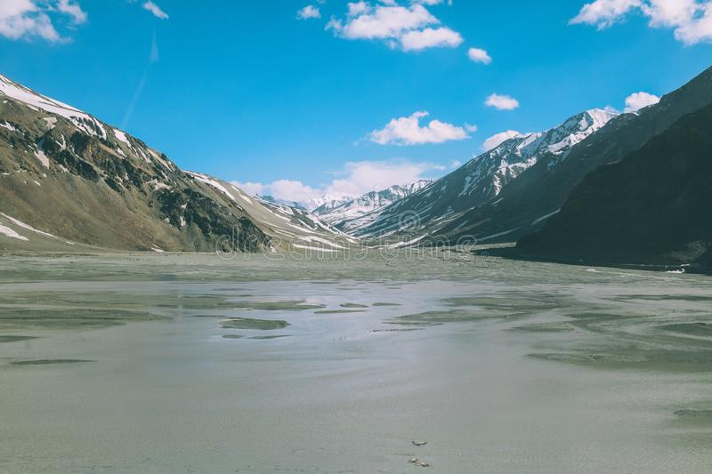 Beautiful mountain valley with lake and snow capped peaks on Indian Himalayas,. Ladakh region royalty free stock photography