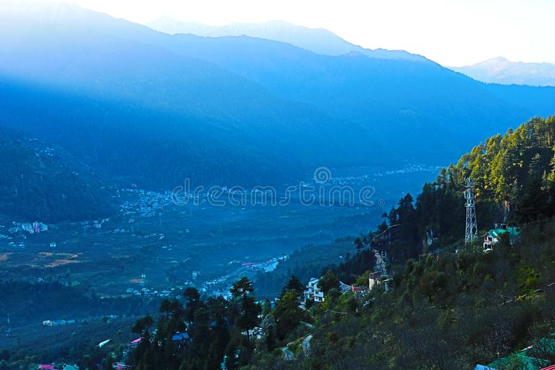 Beautiful mountain valley view with green trees royalty free stock images