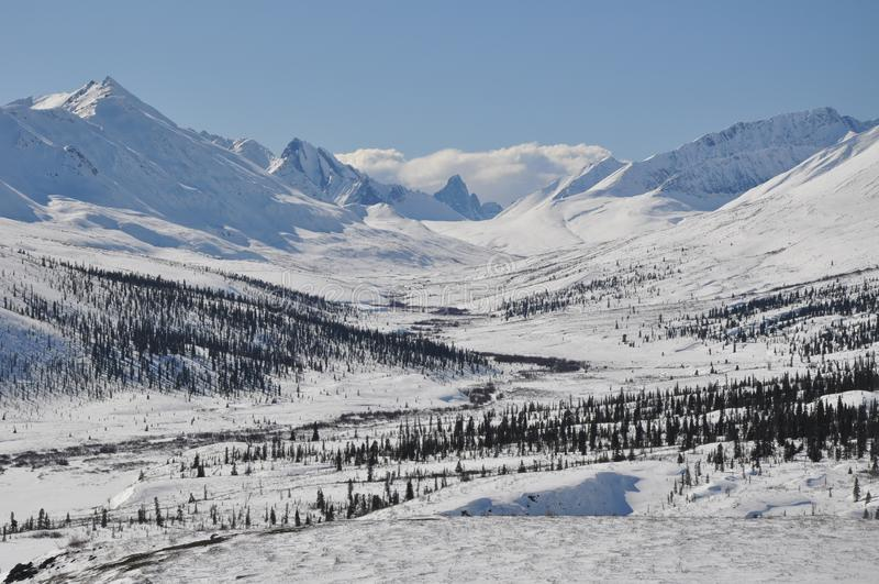 Winter Mountain Scene at Tombstone Territorial Park, Yukon. Beautiful mountainous winter scene on a sunny day in Tombstone Territorial Park on the Dempster stock photos