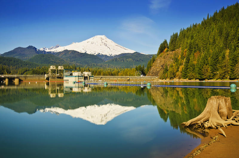 Beautiful Mt Baker reflection and The Baker lake dam. Beautiful Mt Baker reflection over Baker Lake and The Baker lake dam royalty free stock image