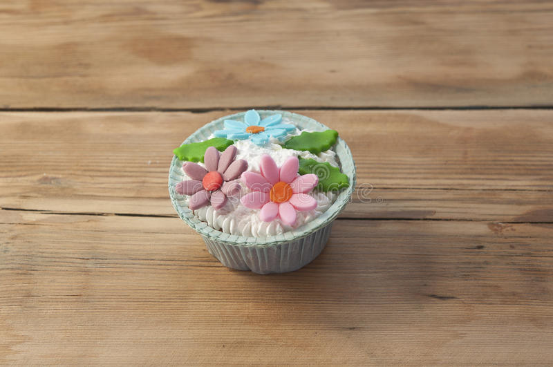 Beautiful muffins decorated with spring flower royalty free stock images