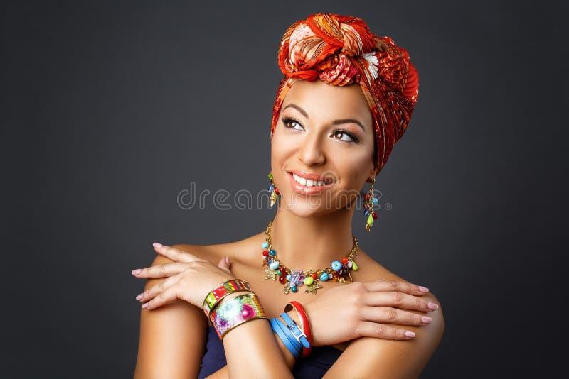 Beautiful mulatto young woman with turban on head stock photo