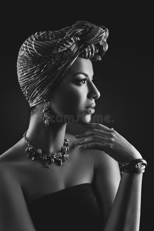 Beautiful mulatto young woman with turban on head stock photography