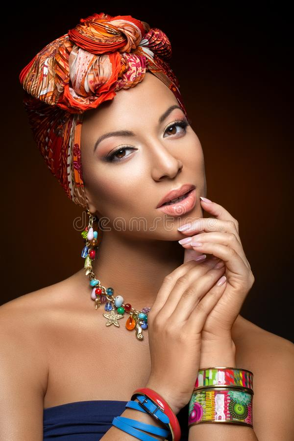 Beautiful mulatto young woman with turban on head royalty free stock photo