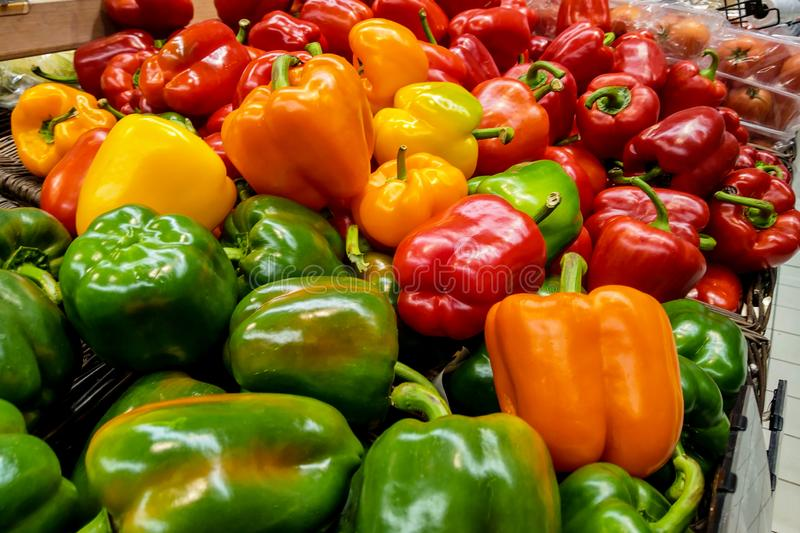 Beautiful multi-colored fresh peppers at the grocery store royalty free stock photos