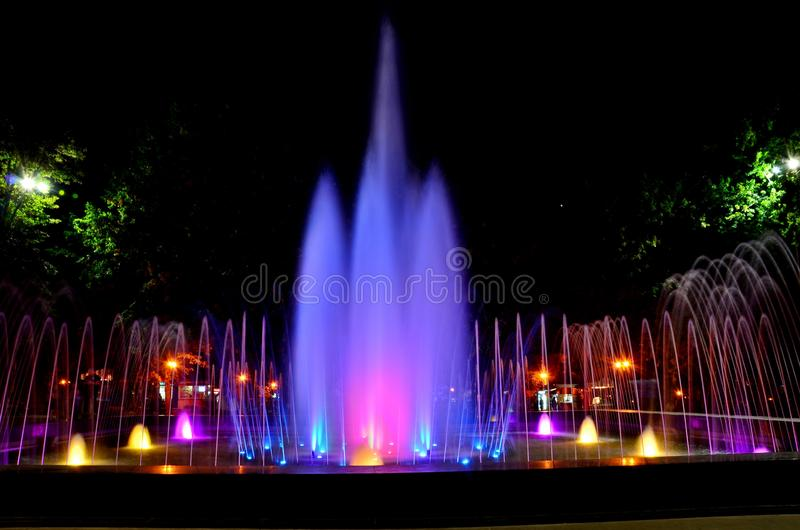 Beautiful multi-colored musical fountain in Kharkov, Ukraine.  stock photo