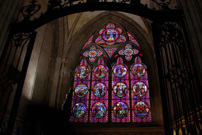 Beautiful multi-colored stained glass windows in the main Gothic cathedral of Rouen North Dame royalty free stock image
