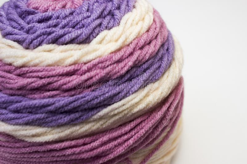 Beautiful multi-colored yarn on a white background. Beautiful striped multi-colored yarn for knitting on white background royalty free stock photos