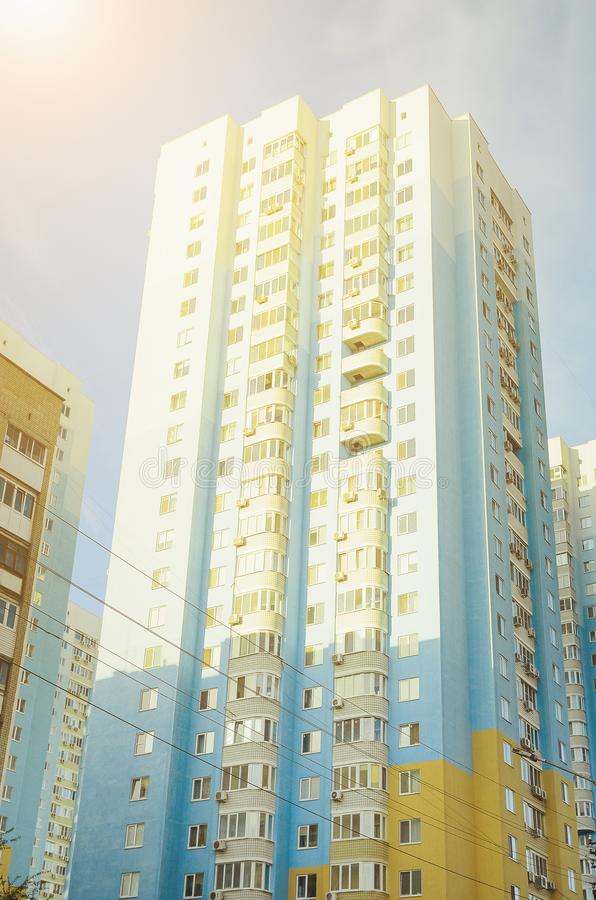 A beautiful multi-storey house , elements of a modern new residential building. Vertical photography. A beautiful multi-storey house , elements of a modern new royalty free stock photos