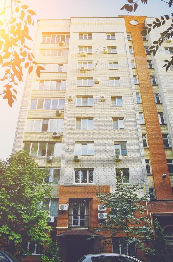 A beautiful multi-storey house of red and white brick, elements of a modern new residential building. City architecture stock photography