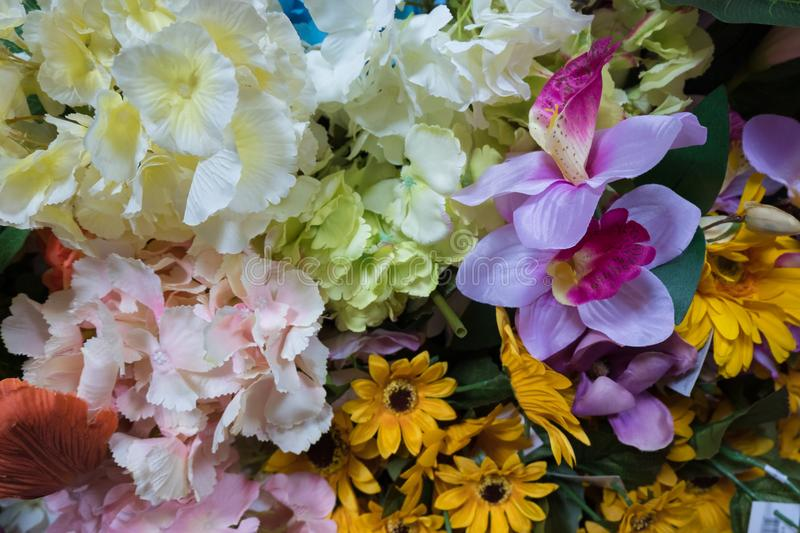 Beautiful multicolored artificial fabric flowers background. royalty free stock image
