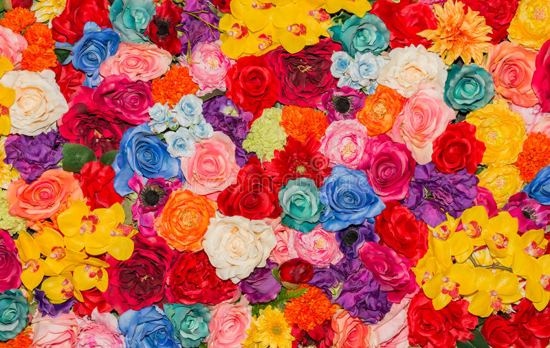 Beautiful multicolored artificial flowers background. stock image