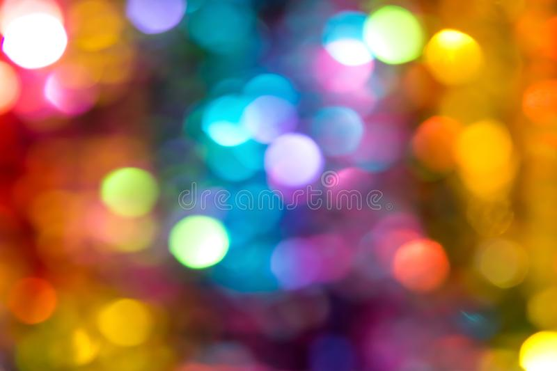 Beautiful multicolored bokeh lights holiday glitter background for Christmas New Year Birthday celebration stock photography