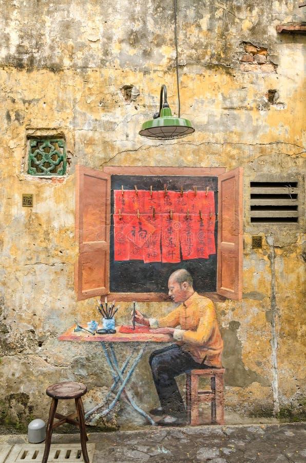 Beautiful mural art of the chinese calligrapher painted at the Kwai Chai Hong`s lane Prankster lane royalty free stock photo
