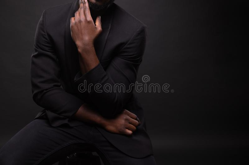Beautiful and muscular black man in dark background. stock images