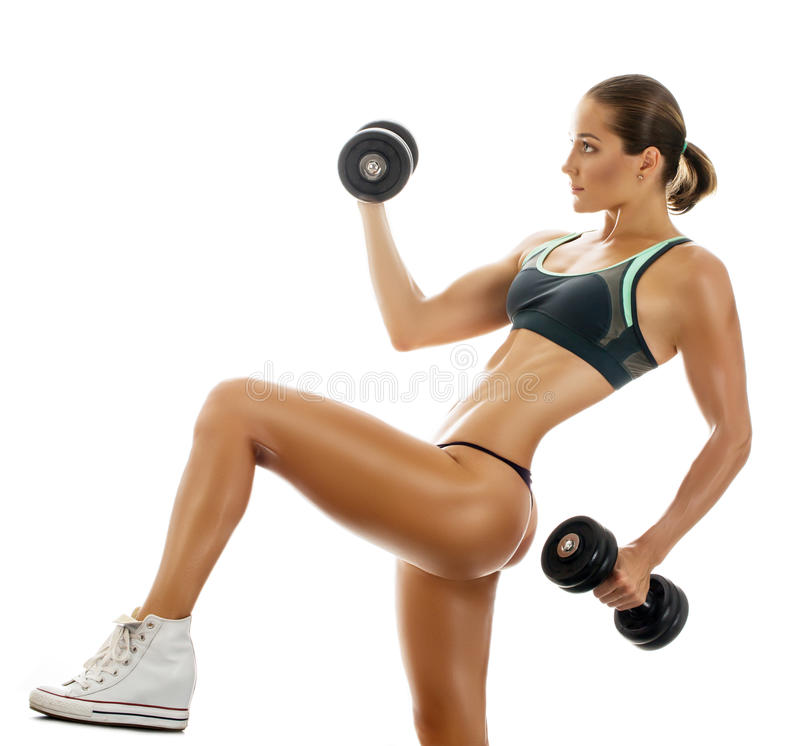Beautiful muscular fit woman royalty free stock photography