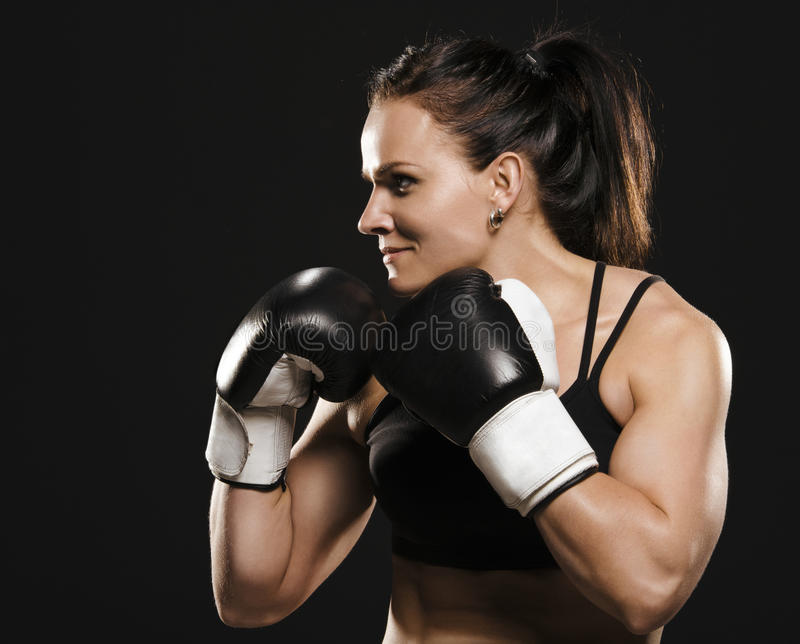 Female fighter ready to fight. royalty free stock photo