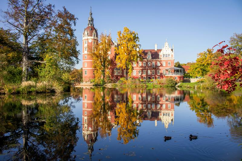 Beautiful Muskau Palace, located in Muskau Park in Bad Muskau, Saxony, Germany, in scenic colorful autumn scenery.  Since 20 royalty free stock photos