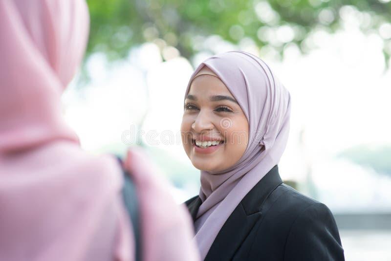 Muslim business woman talking royalty free stock photos