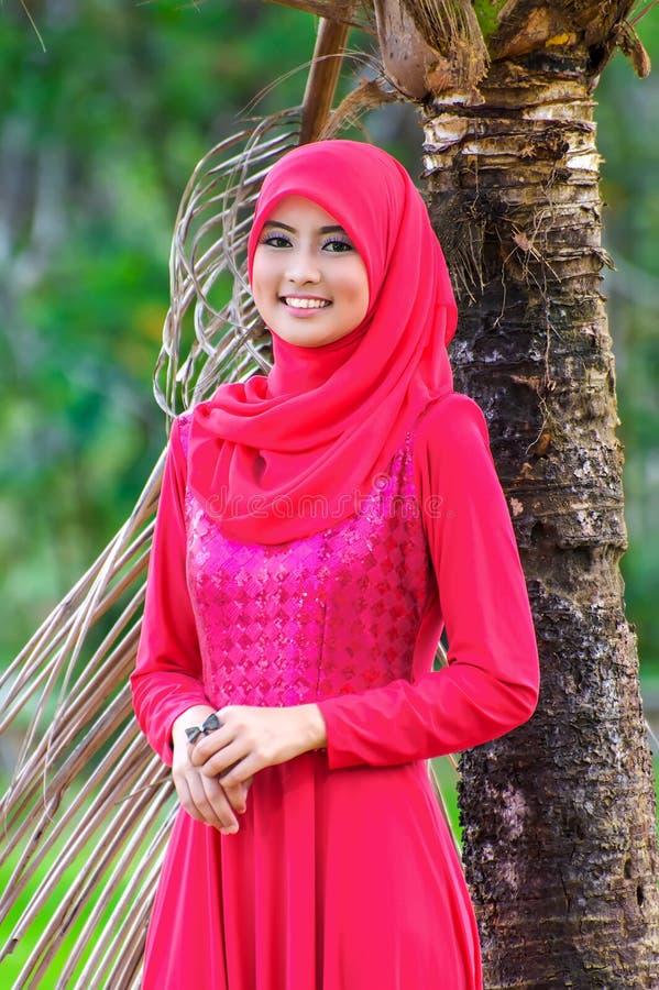 Beautiful muslimah lady wear blouse and hijab. Posing at garden stock image