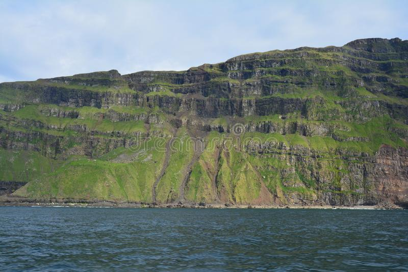 The beautiful Mykines island in The Faroe Islands. The amazing scenic landscapes that the hike to the lighthouse on Mykines island offers royalty free stock photos